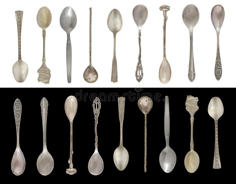 9 Vintage Tea Spoons isolated on a black and white background. Rustic style. Silverware stock photography