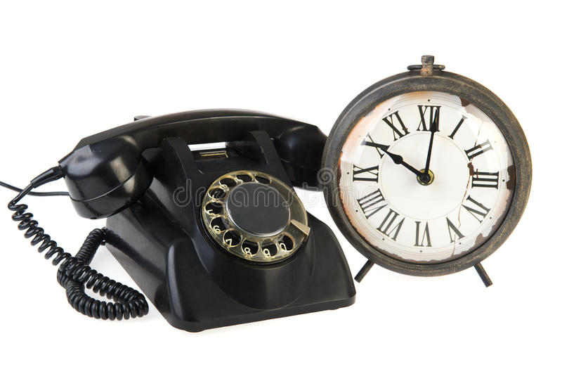 Vintage Telephone And Clock Stock Images