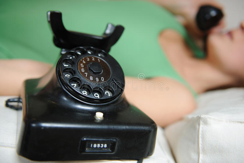 Vintage telephone and girl