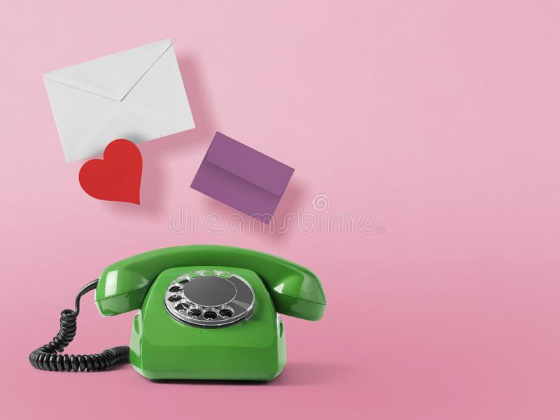 Vintage telephone on pink royalty free stock images
