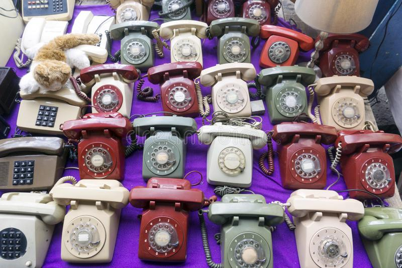 Vintage telephones for sale in the flea market.  royalty free stock photography