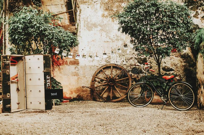 Vintage terrace in a mexican colonial house with a bicycle royalty free stock images