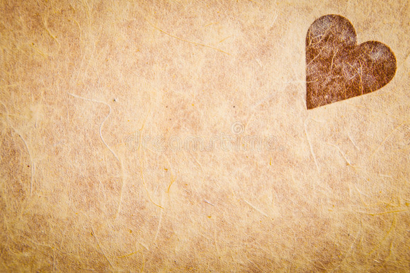 Vintage Textured Paper With Heart royalty free stock photography