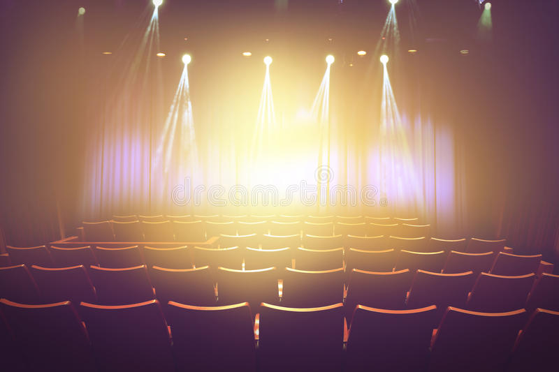 Vintage theater with lighting spot on stage before showtime royalty free stock photo