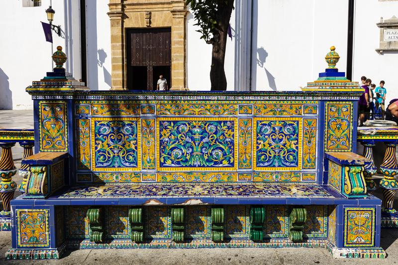 Vintage tiles decorated public bench in Spain. royalty free stock image