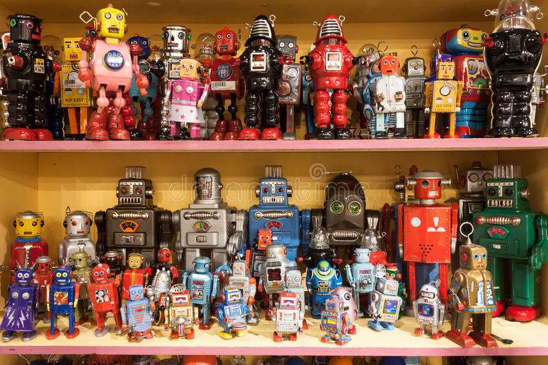 Vintage tinplate robots on display at HOMI, home international show in Milan, Italy royalty free stock photography