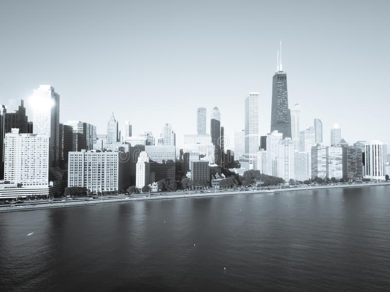 Filtered image top view Chicago skyscrapers from Michigan lake with morning autumn light royalty free stock photography