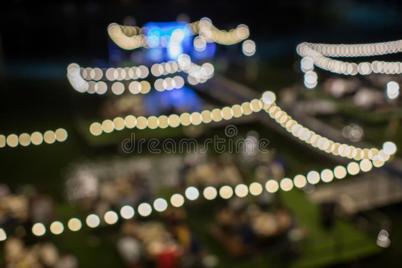 Vintage tone blur image of food stall at night festival with bokeh for background usage. Festival Event Party with People Blurred Background. Blur people stock photos