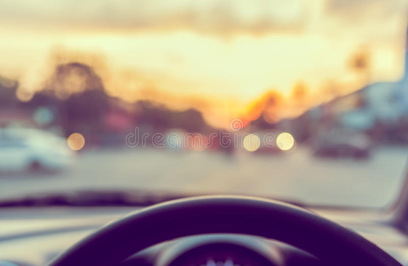 Vintage tone blur image of people driving car on day time. Blur image of people driving car on day time for background usage. & x28;take photo from inside& x29 royalty free stock images