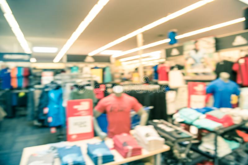 Filtered image blurry background mannequins at American sport and fitness clothing store stock image