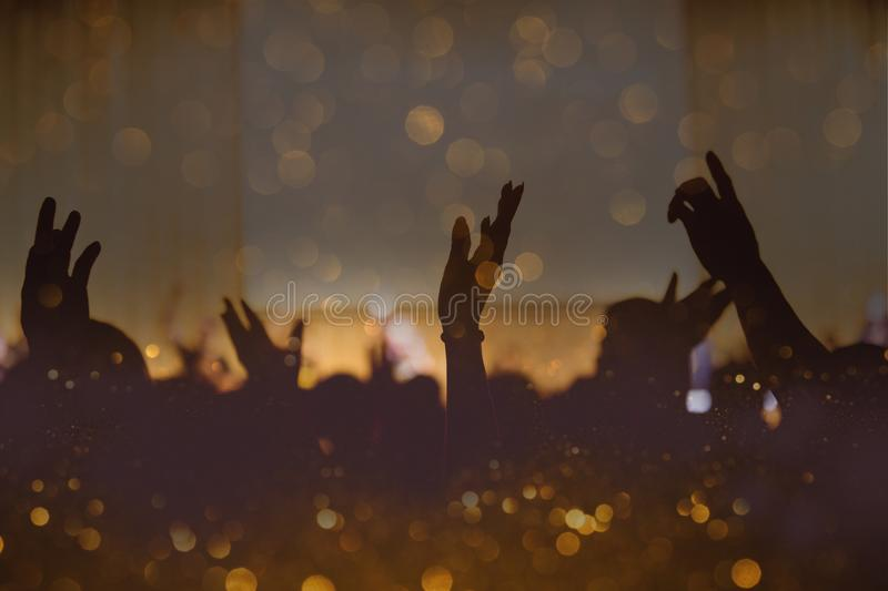 Vintage tone of christian music concert with raised hand stock photography