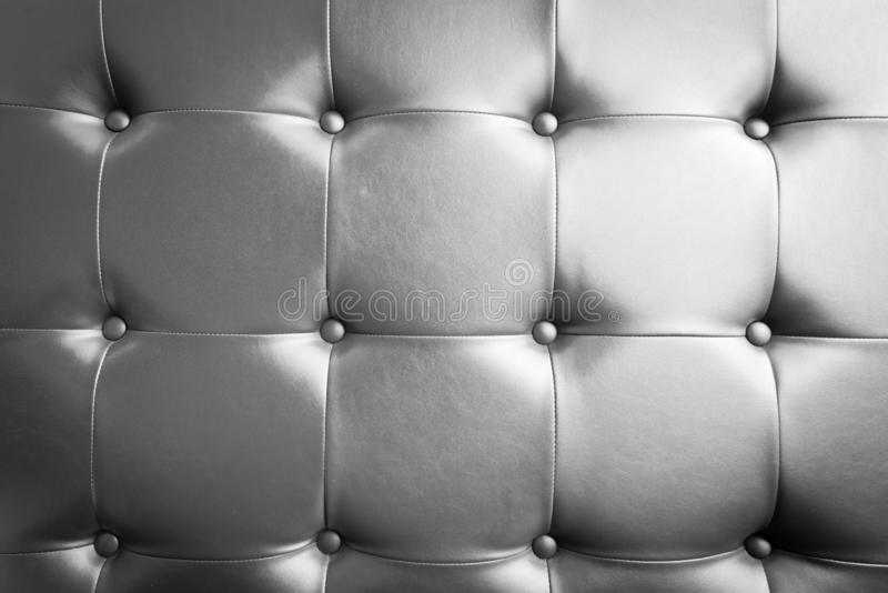 Filtered image brown leather texture couch as mock up and background usage. Vintage tone close-up leather details on sofa, elegant tan leather texture with royalty free stock photos