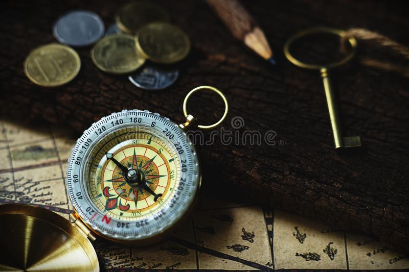 Vintage tone compass, coin, key and map, antique travel concept. Copy space royalty free stock photo