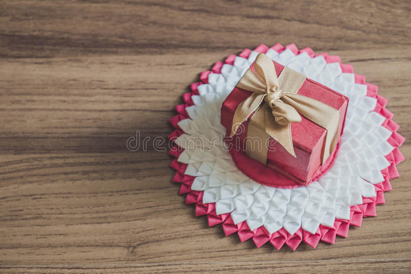 Vintage tone, red gift box on wooden background royalty free stock photos