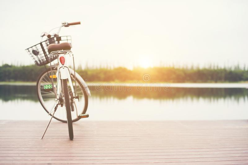 Vintage toned of bicycle with basket on empty pier, summer day. royalty free stock photography