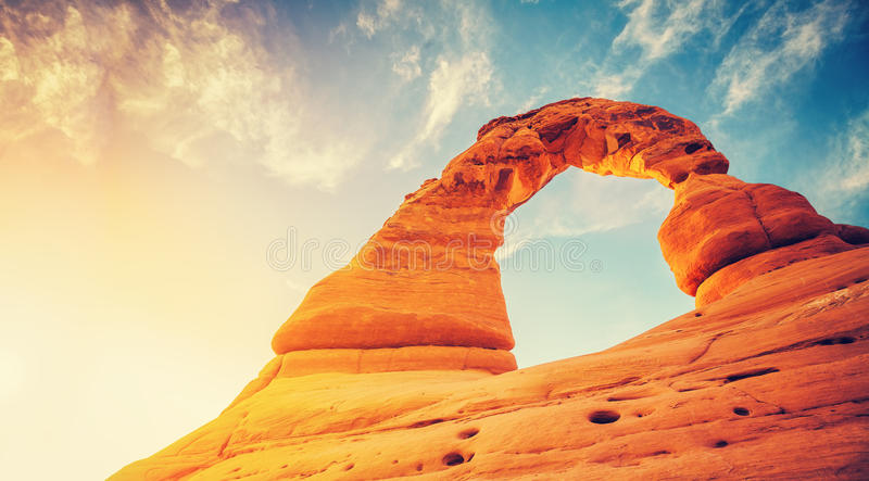 Vintage toned Delicate Arch at sunset. stock images