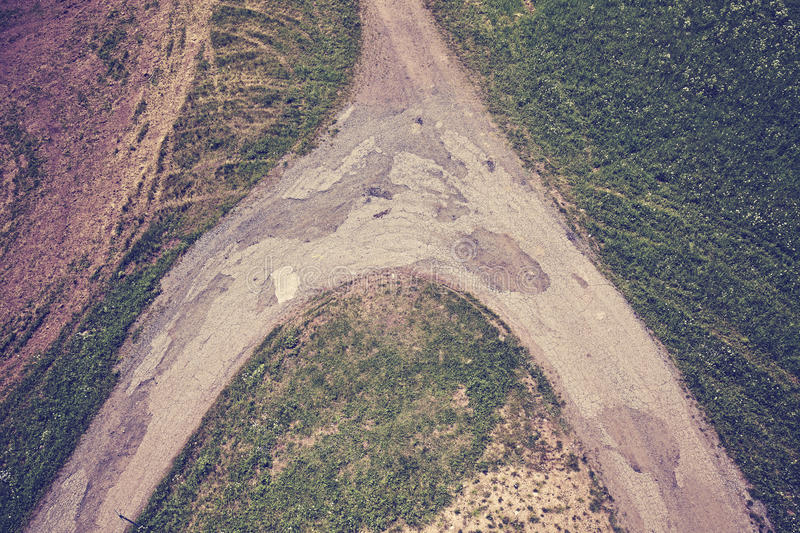 Vintage toned dirt road crossroads seen from above. royalty free stock photography