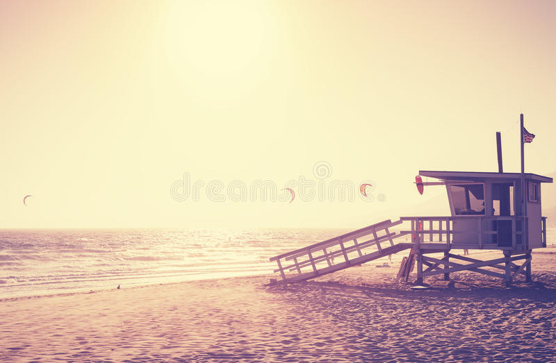 Vintage toned picture of lifeguard tower at sunset, Malibu. royalty free stock image