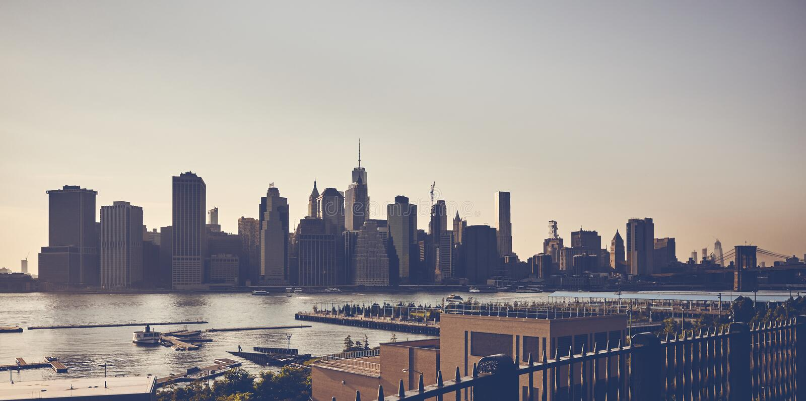 Vintage toned picture of New York City silhouette at sunset. Vintage toned picture of New York City silhouette seen from the Brooklyn Heights Promenade at sunset stock photos