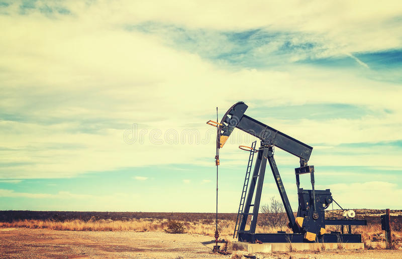 Vintage toned picture of an oil pump jack, Texas. royalty free stock image