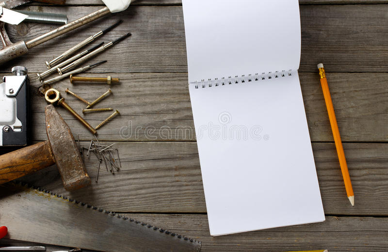 Vintage tools with a notebook with blank pages royalty free stock photos