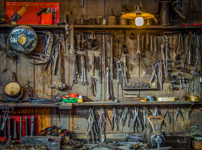 Vintage Tools Workshop. Vintage Tools Hanging On A Wall In A Tool Shed Or Workshop stock photo