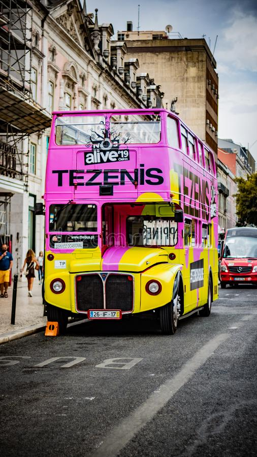 Vintage tourist sight seen bus parked in lisbon street. Date july 2 2029 royalty free stock photos