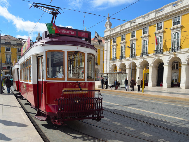 Vintage Tourist Sightseeing Tram on the Praca do Comercio Lisbon Portugal. stock photos