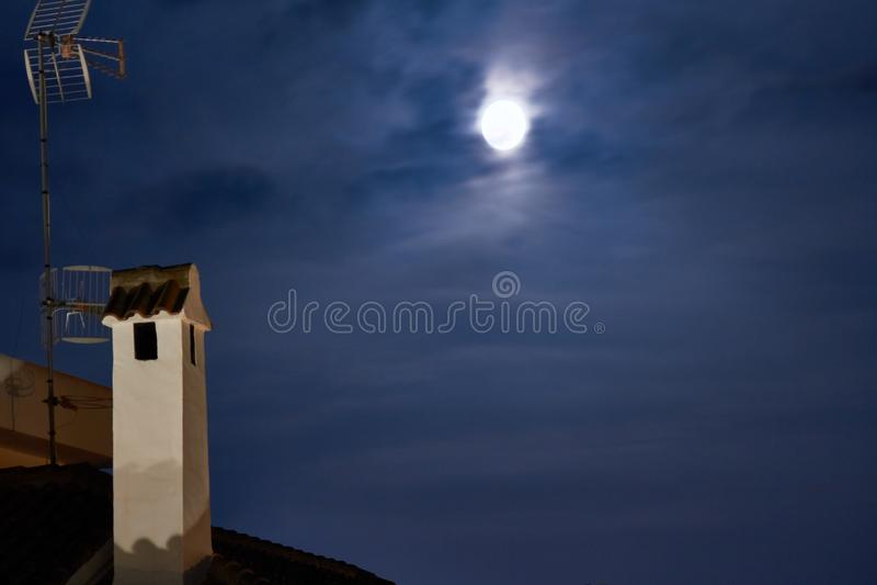 Vintage town at night. Bright moon. Brick house roof. Vintage town at night. Bright moon stock images