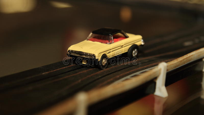 Vintage Toy Car On Racing Track. A close-up photo of an antique toy car on a plastic racetrack stock images