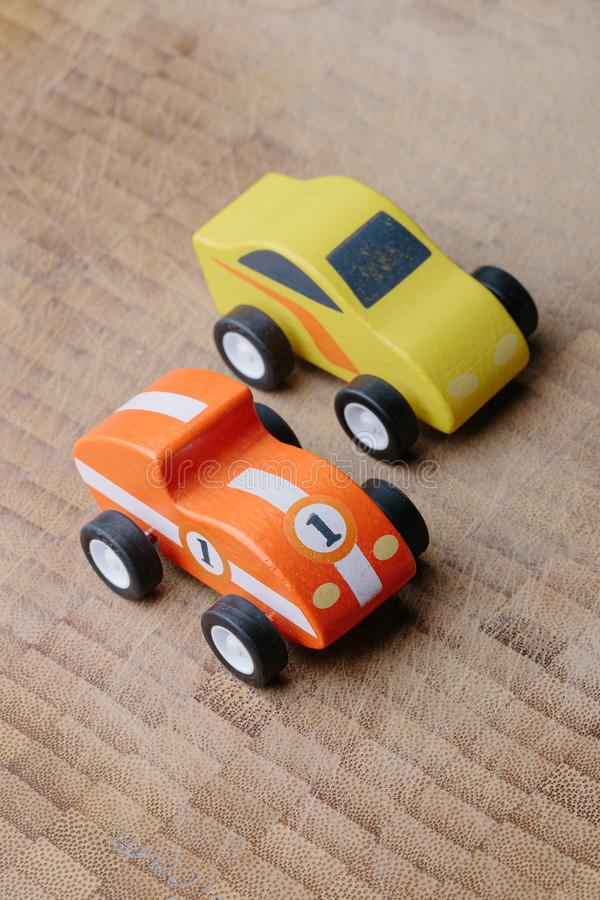 Vintage toy cars in a row on a wooden surface stock images