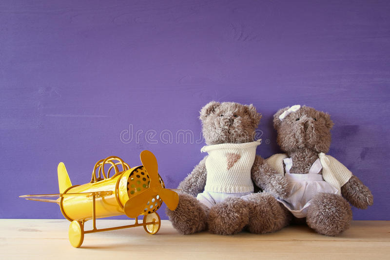 vintage toy plane and couple of cute teddy bears stock photo