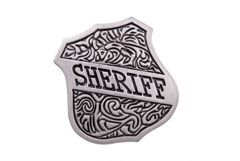 Vintage toy sheriffs badge stock photo