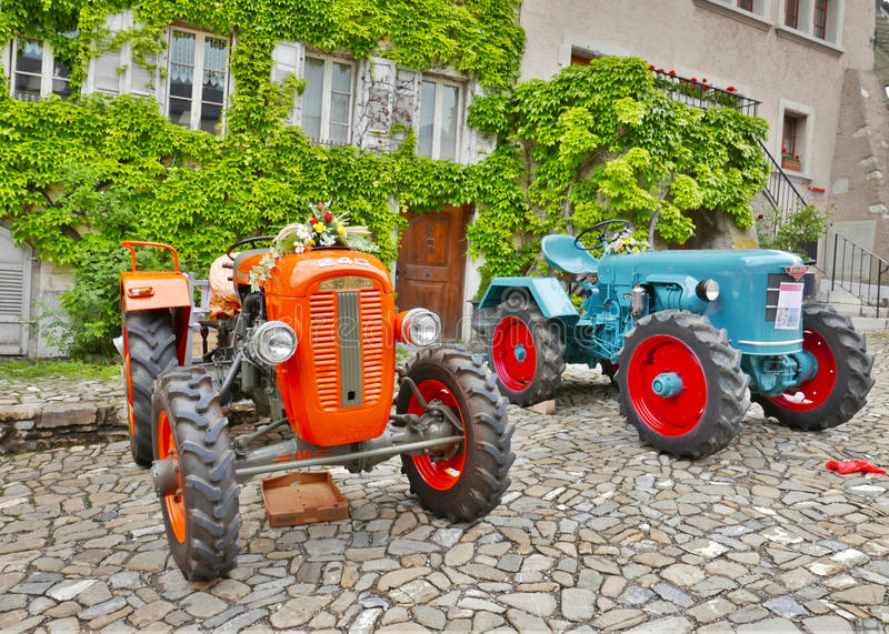 Vintage tractors. Old SAME and Sulzer tractors in perfect condition at Gruyeres village, Switzerland stock image