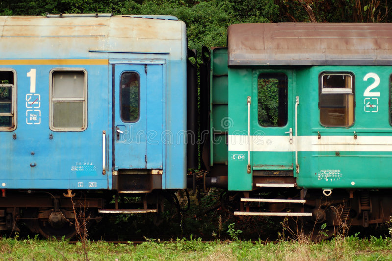 Vintage train cars. Vintage train cars in blue and green royalty free stock images