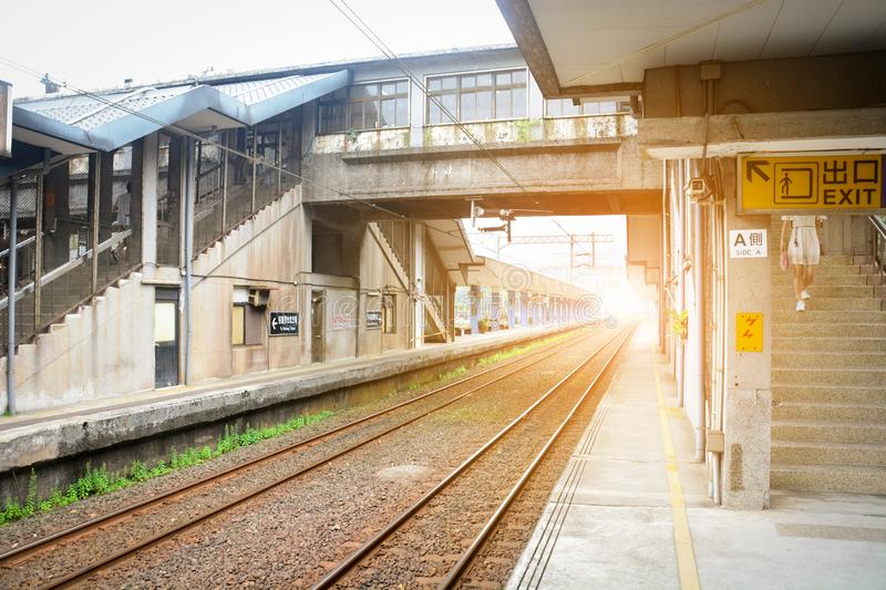 Vintage train platform, railway station, building for crossing railroad tracks with sunset background, Taiwan stock image