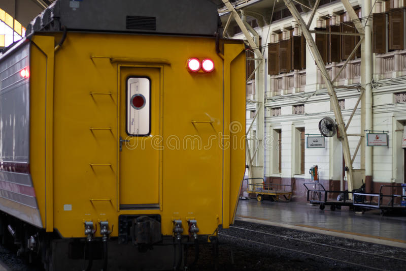 Vintage train to depart from station. Railroad track stock photo