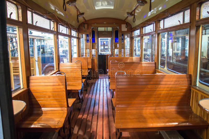 Vintage tram car interior. With wooden seats stock photos