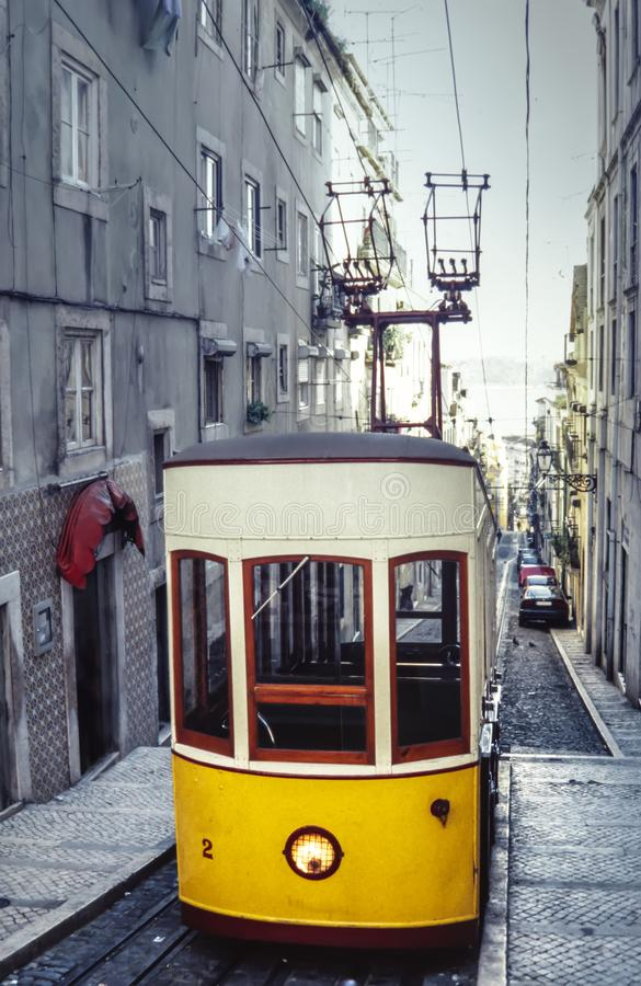 Vintage tram in the city center of Lisbon, Portugal in a summer day. stock photo