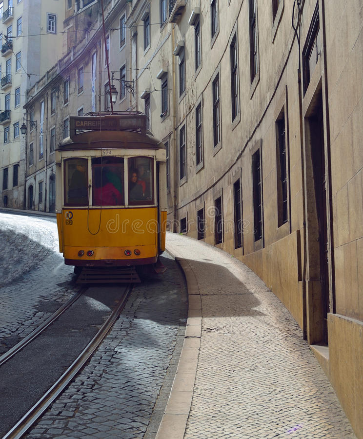 Vintage Tram in a quiet historic street of Lisbon Portugal royalty free stock images