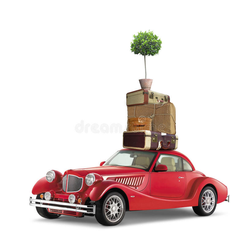Vintage travel. Ing concept with red classic car and luggage isolated on white stock image