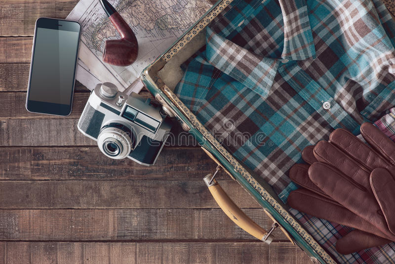 Vintage traveler packing stock photography