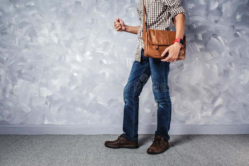 Vintage travelling men fashion with leather bag handsome thin ma stock photo