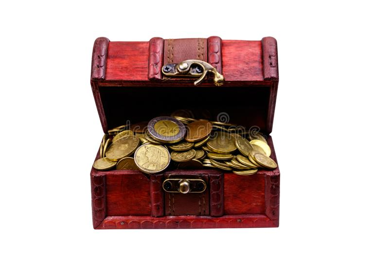 Vintage treasure chest full of golden coins isolated on white background. Vintage treasure chest full of golden coins isolated on a white background stock photo