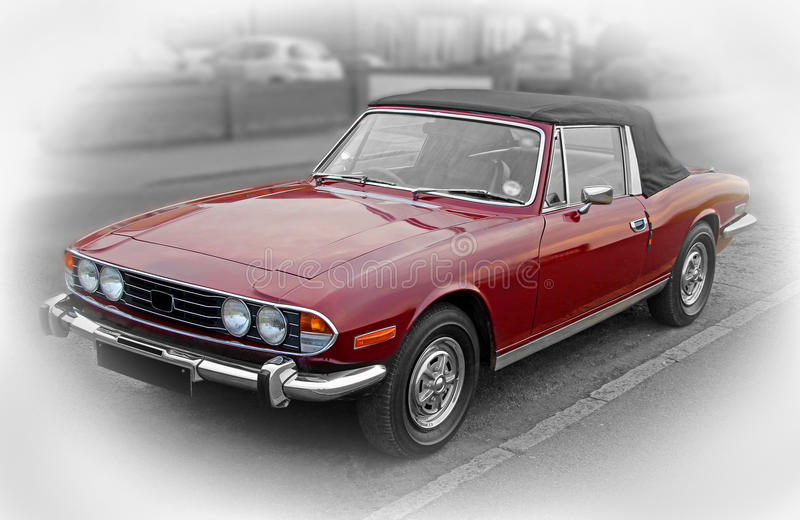 Vintage triumph stag car. Photo of a vintage triumph stag car with soft top hood convertible in red colourway stock images