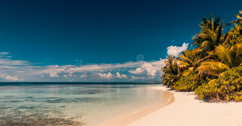 Vintage Tropical beach background. Crystal clear water and luxury water bungalows. Tropical tranquil background concept. Vintage style exotic scene stock photography
