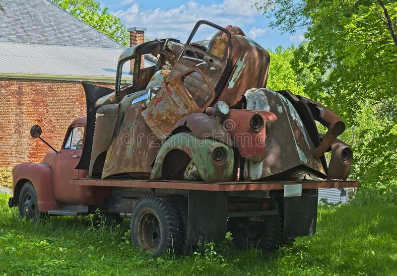 Vintage truck with old car parts stock photo