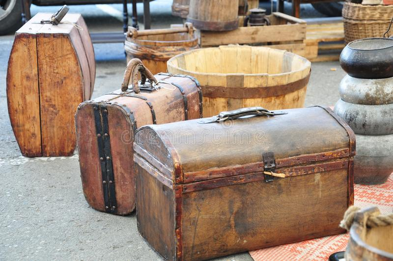 Vintage trunks. And other stuff for display in a flea market stock photos