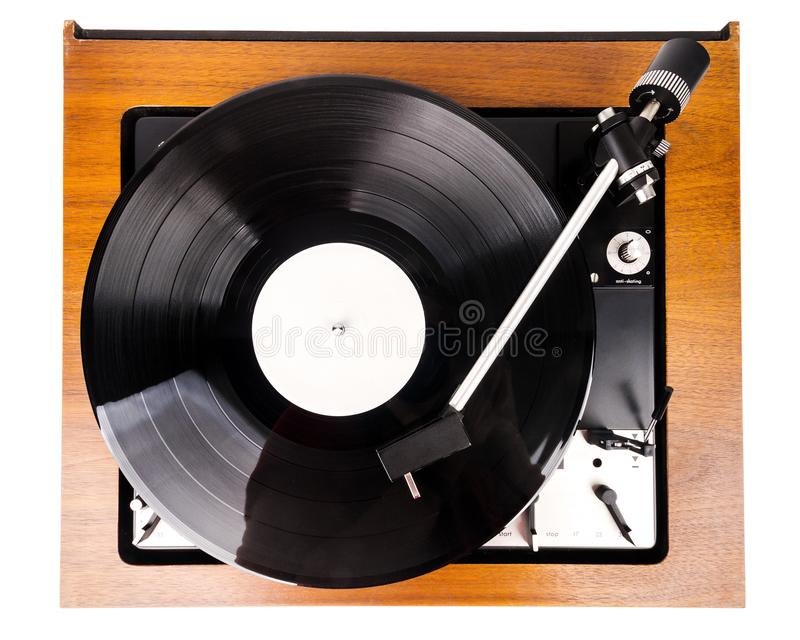 Vintage turntable with a black vinyl isolated on white. Wooden plinth. Retro audio equipment royalty free stock photography
