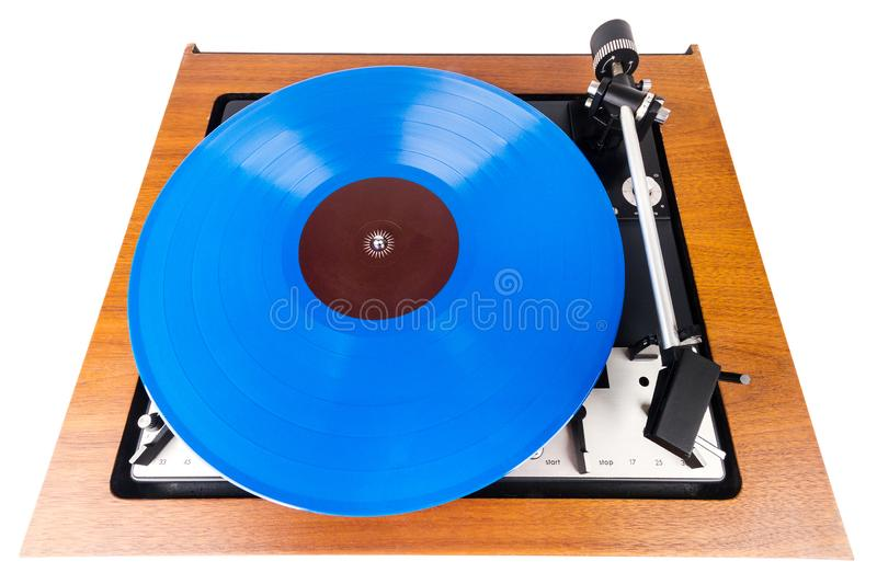 Vintage turntable with a blue vinyl isolated on white. Wooden plinth. Retro audio equipment royalty free stock photos